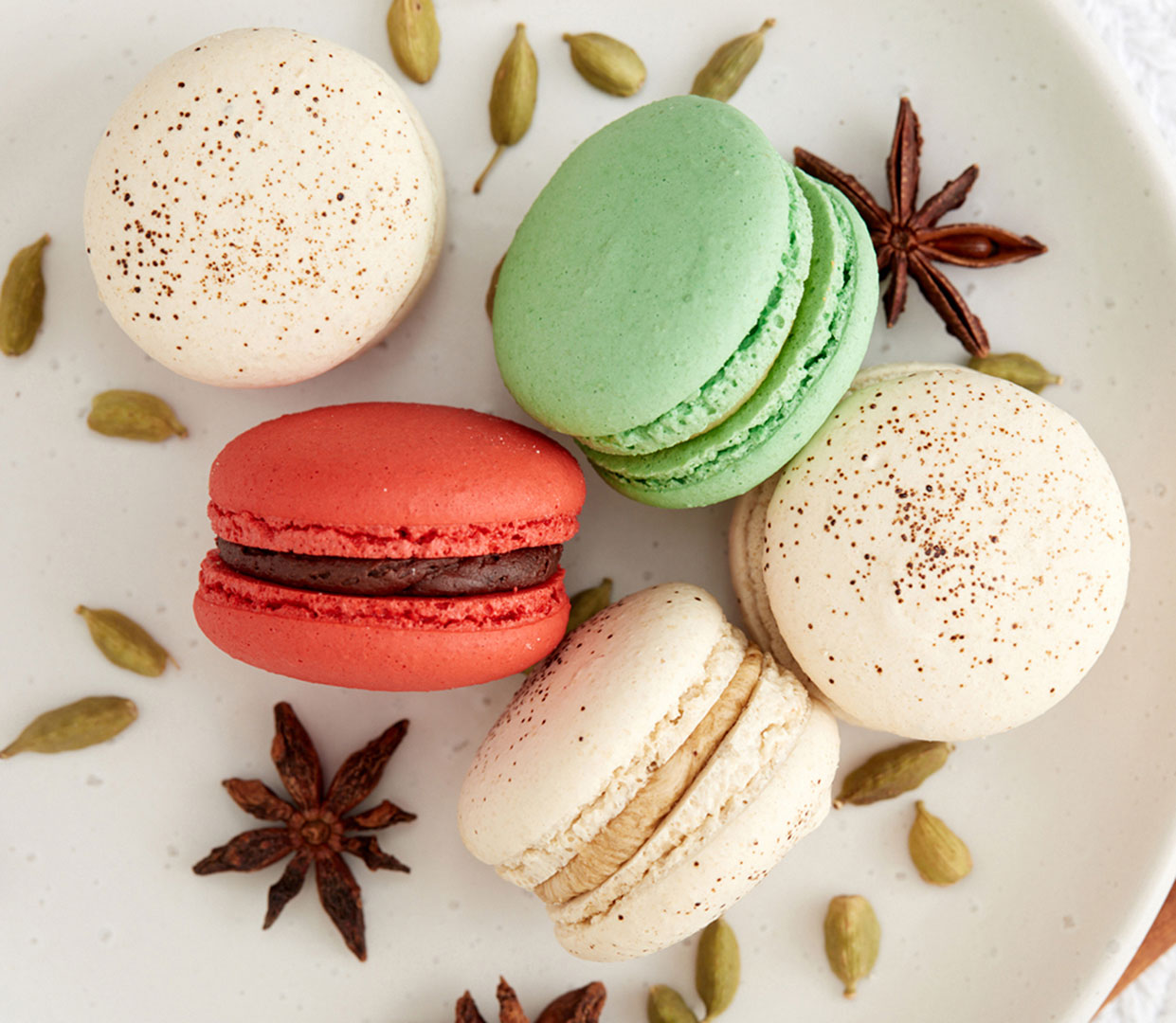 Food and beverage photographer Kate Benson shot and styled these white, red, and green macroons.