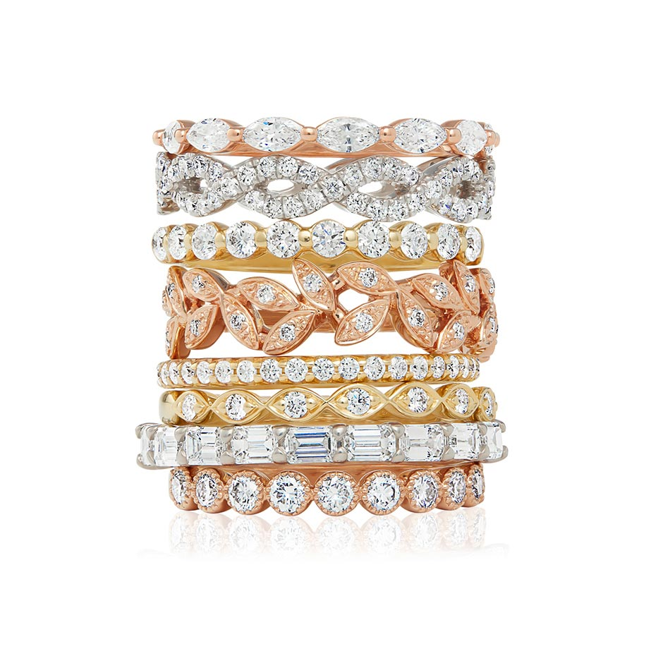 Stacked diamond and gold rings photographed by fine jewelry photographer Kate Benson.
